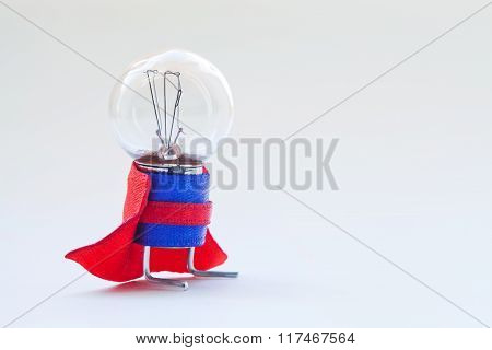 Light bulb in super hero costume. Skillful, expert man original concept. Vintage lamp with ideal sph