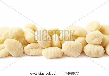 Line of multiple gnocchi dumplings