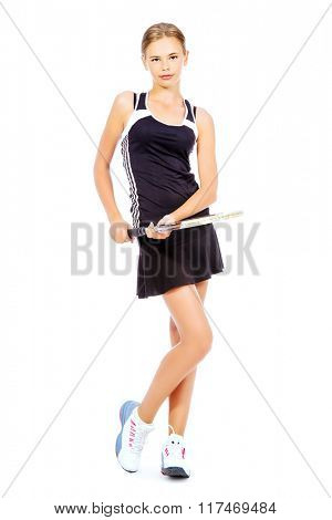 Full length portrait of a girl tennis player holding her racket. Studio shot. Isolated over white.