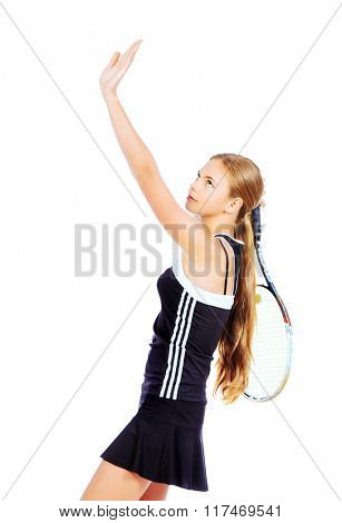 Portrait of a girl tennis player in motion. Studio shot. Isolated over white.