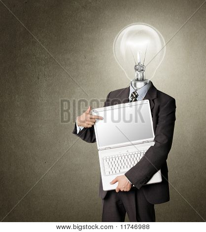 Businessman With Lamp-head With Open Laptop Shows Something