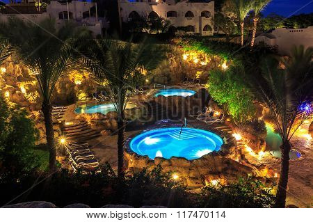 Evening view for luxury swimming pools in night illumination