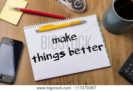 Make Things Better - Note Pad With Text On Wooden Table