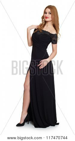 Young woman in black evening gown. Full length  on white.