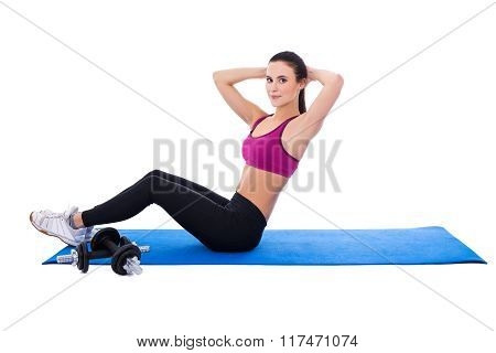Slim Woman Doing Exercises For Abdominal Muscles Isolated On White