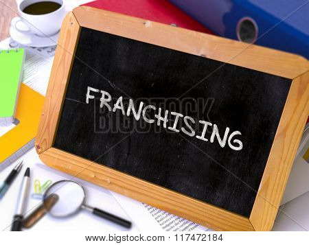 Franchising - Chalkboard with Hand Drawn Text.