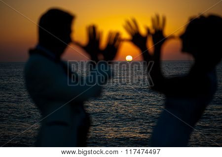 Silhouettes Of Couples .tease Each Other