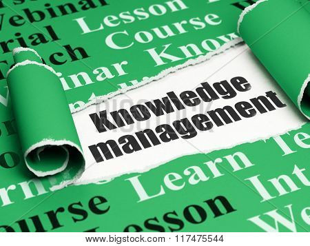 Education concept: black text Knowledge Management under the piece of  torn paper