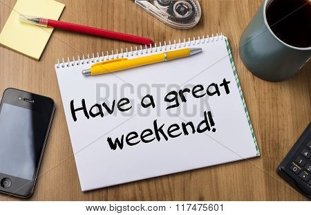 Have A Great Weekend! - Note Pad With Text On Wooden Table
