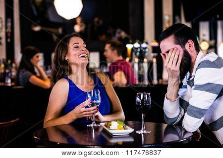 Couple having a glass of wine in a bar