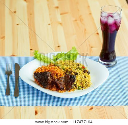Tasty Dish Of Roast Beef With Rice And Salad Leaves And A Glass Of Juice With Ice