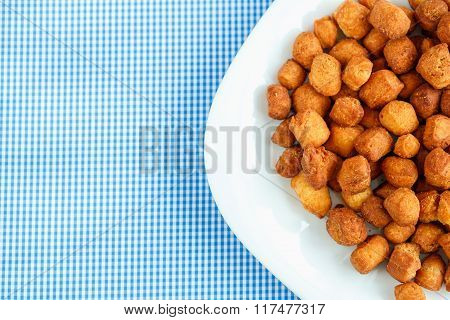 Cookies On A White Plate And Blue Checkered Tablecloths