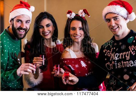 Festive friends having shots in a bar