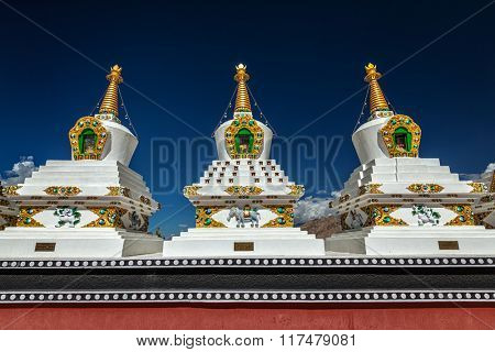 White chortens (Buddhist stupas) in Thiksey gompa. Ladakh, Jammu and Kashmir, India