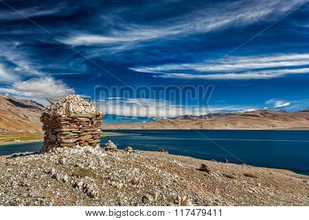 Stone cairn at Himalayan lake Tso Moriri, Korzok,  Changthang area, Ladakh, Jammu and Kashmir, India