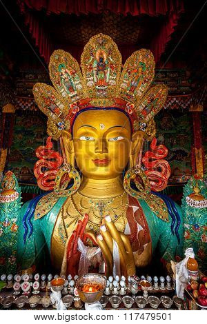 Maitreya Buddha statue face close up in Thiksey Gompa. Ladakh, India