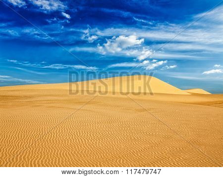 White sand dunes in desert on sunrise, Mui Ne, Vietnam.