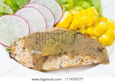 Selective Focus Of Chicken Steak On Wood Background With Black Pepper Sauce And Salad