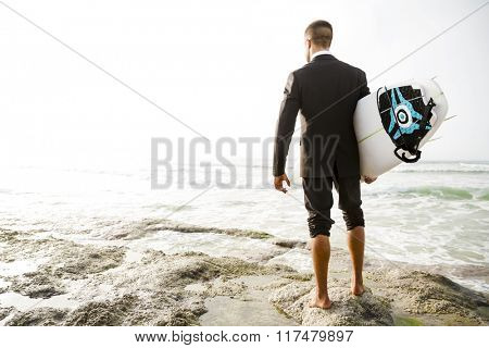 A Businessman holding is surfboard after a long day of work
