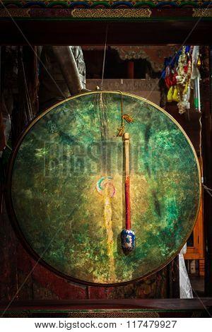 Large tibetan drum with beater in Hemis gompa (Tibetan Buddhist monastery). Ladakh, India
