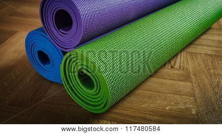 Yoga background banner - panoramic image of Yoga mats on wooden floor