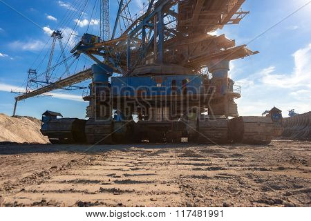 Large excavator machine in the mine