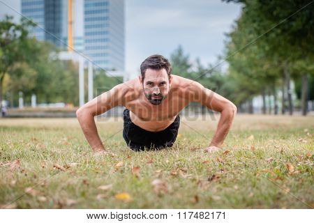 Man doing push-up as sport for better fitness