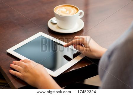 business, people, technology and lifestyle concept - close up of woman with tablet pc computer and coffee