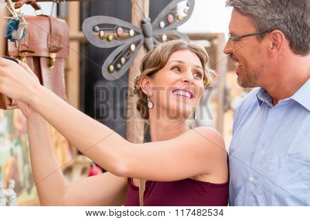 Woman and man looking for antiques at flea market