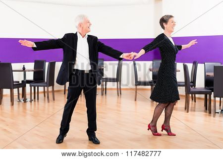 Senior woman and man in dance class training