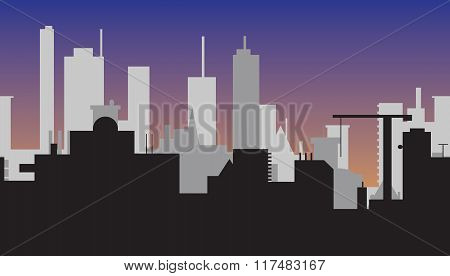 Silhouette of abstract town at sunset