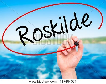 Man Hand Writing Roskilde With Black Marker On Visual Screen