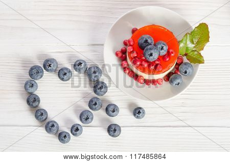 Frame- Heart From Blueberry  And Fruitcake On Wooden Table   Top View
