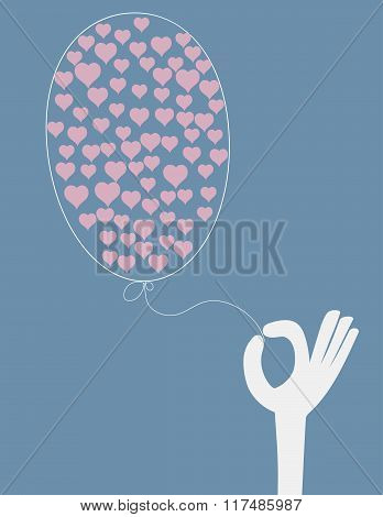 Hand Holding A Balloon With Hearts