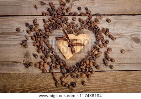 Frame- Heart From Coffee Beans And Two Cookies-heart Related Together Inside It On  Wooden Table