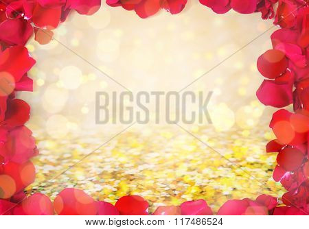 love, romance, valentines day and holidays concept - close up of red rose petals blank frame over golden confetti and lights background