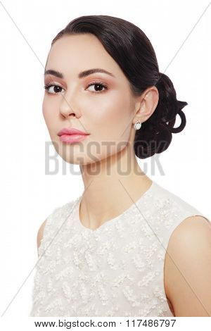 Young beautiful bride with stylish make-up and prom hairdo over white background, copy space