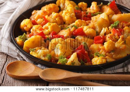 Cauliflower With Potatoes In Curry Sauce On A Plate Close-up. Horizontal