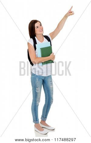 pretty college student pointing empty space