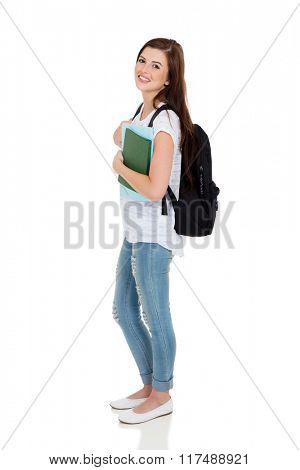 side view of young college student looking at the camera