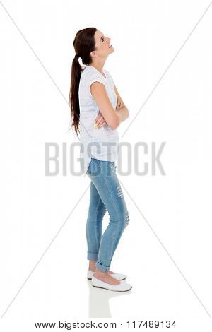 side view of young woman looking up on white background