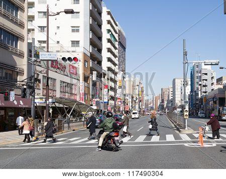 People Cross The Street In Tokyo
