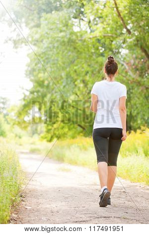 Middle-aged Female Running And Jogging