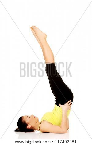 Fitness woman with her legs up.