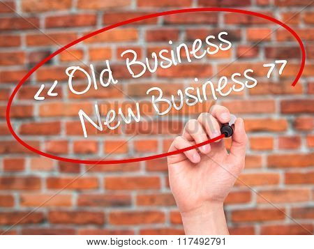 Man Hand Writing Old Business - New Business With Black Marker On Visual Screen