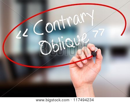 Man Hand Writing Contrary - Oblique With Black Marker On Visual Screen