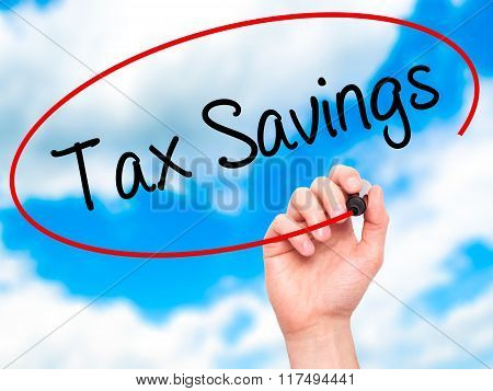 Man Hand Writing Tax Savings With Black Marker On Visual Screen