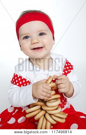 little girl with bread-rings