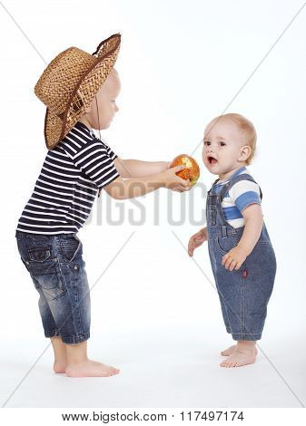 little boy treated friend apple