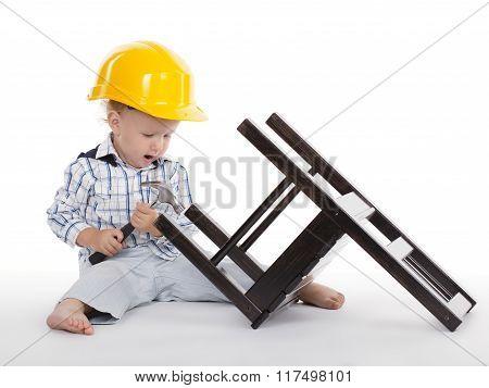 boy repairs wooden chair